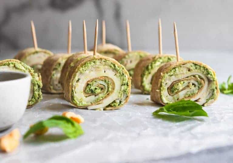 turkey and pesto pinwheels with a toothpick on a plate