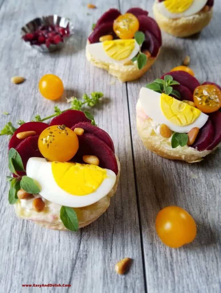 pickle beets and raw egg inside of puff pastry cups