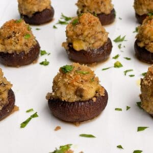 clam stuffed mini mushrooms on a white plate