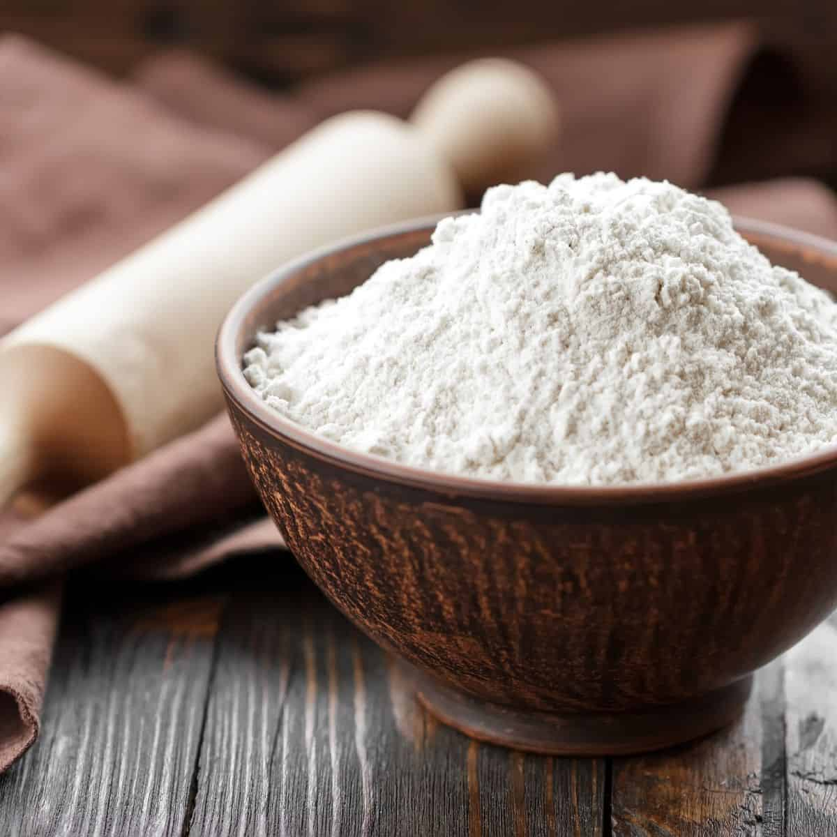 All purpose white flour in a small bowl.
