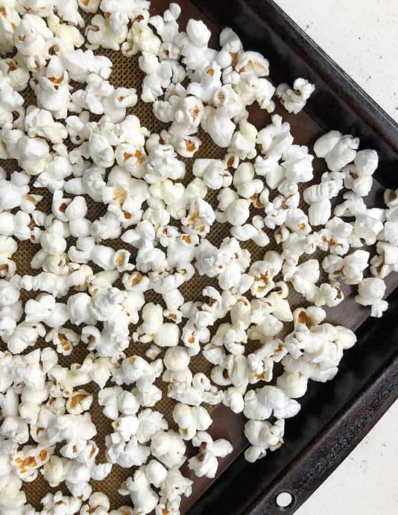 homemade popcorn popped on a baking sheet
