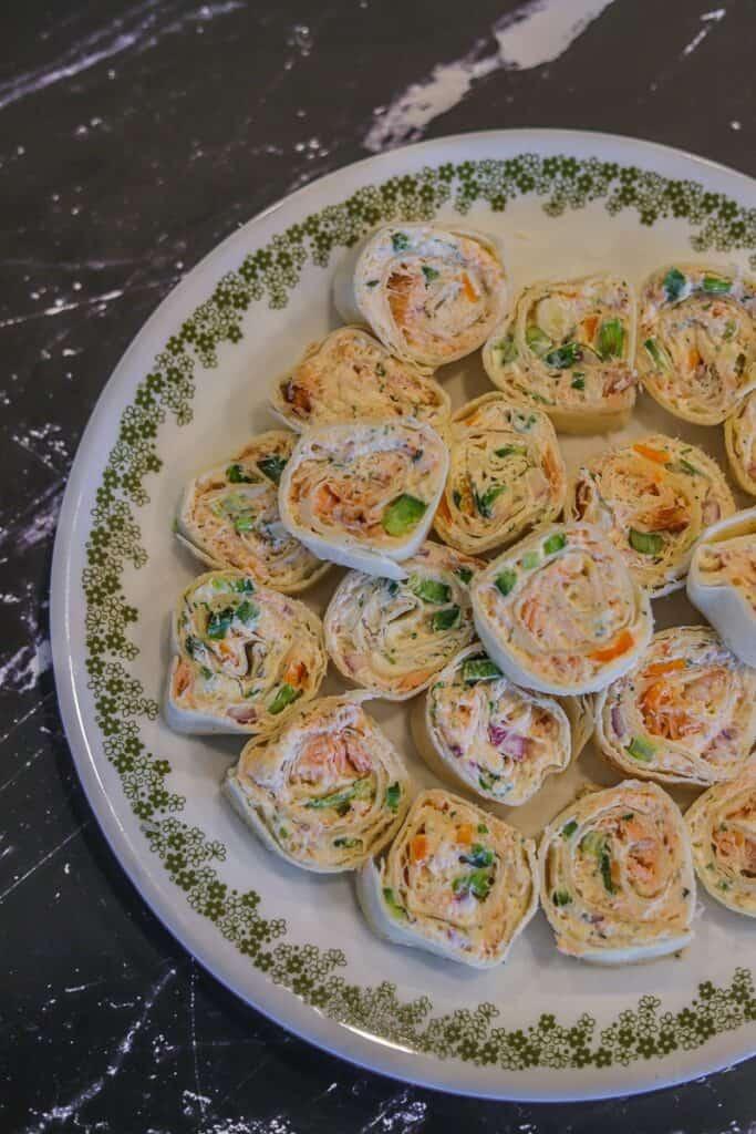 smoked salmon pinwheels on a plate