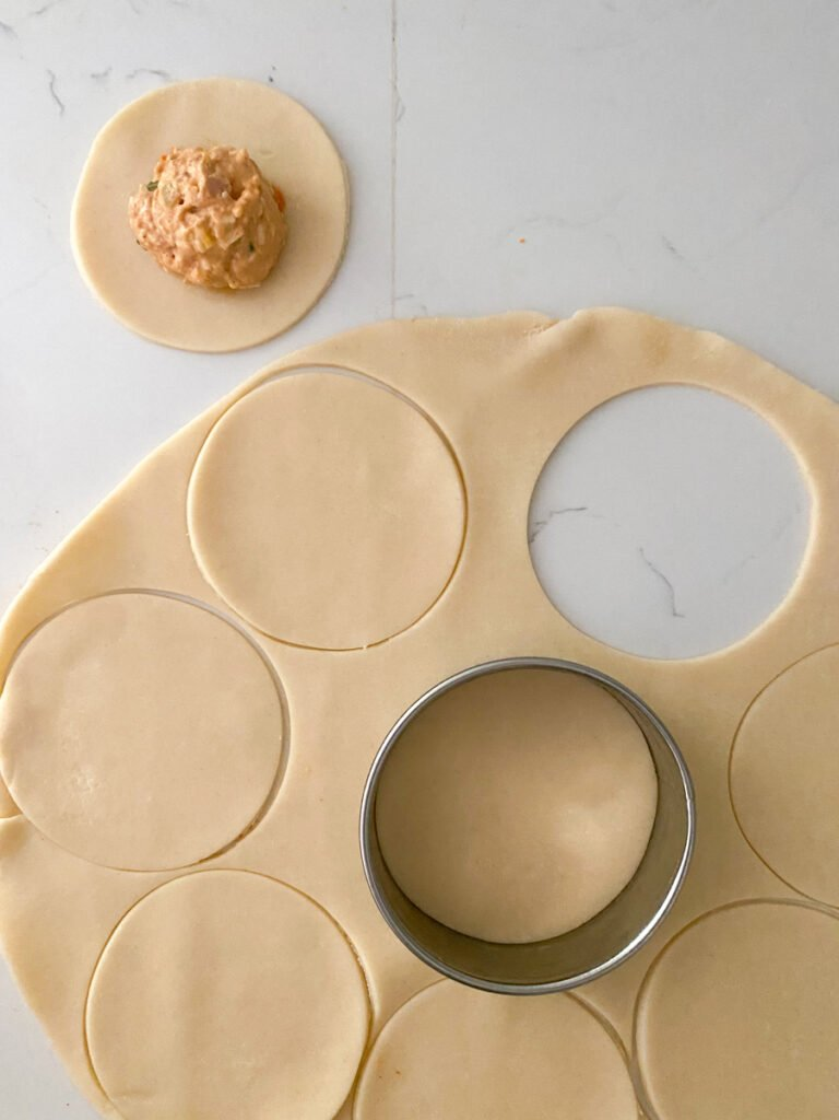 empanada rounds cut from pie dough
