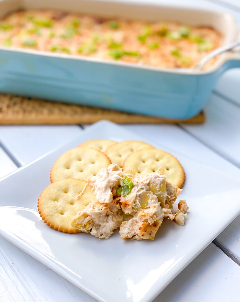 hot crab dip with crackers on a plate