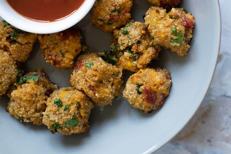 pizza quinoa bites with sauce on the side.