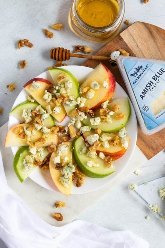 blue cheese and apple slices on a white plate for a party snack