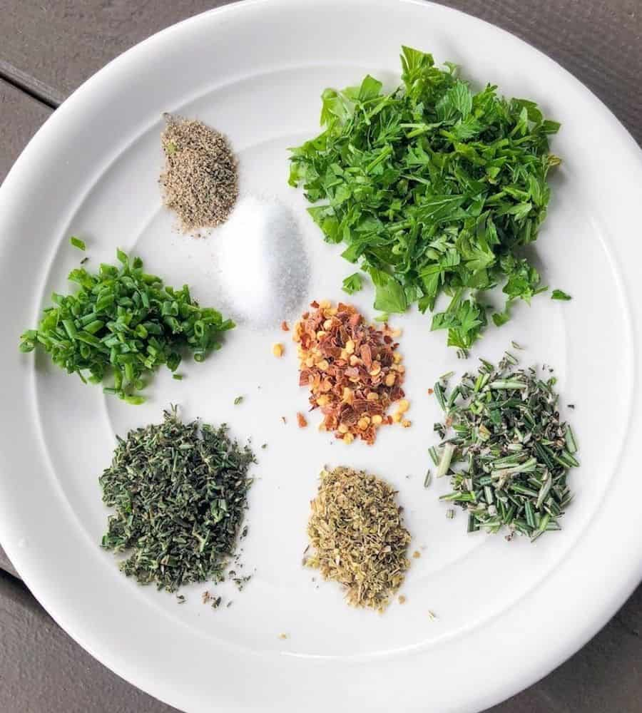 herbs for bread dipping oil on a plate