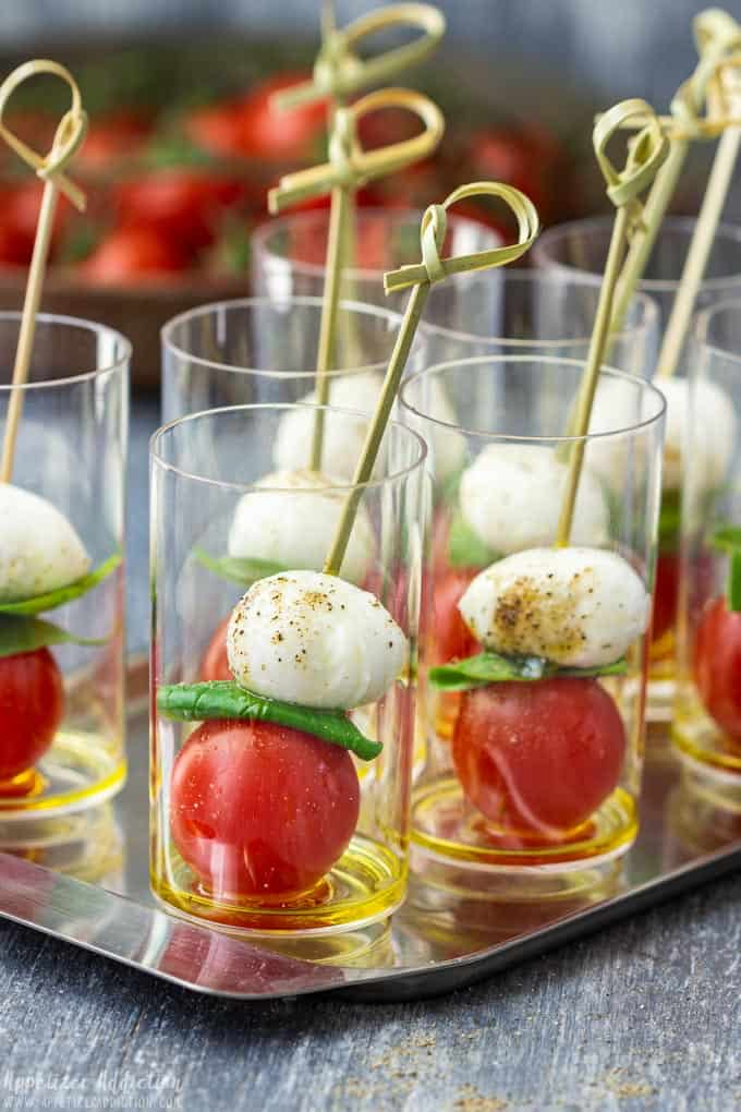 caprese salad appetizer skewers in a mini shooter.