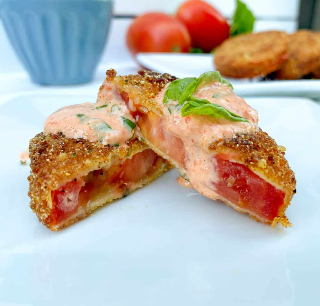 inexpensive fried tomatoes appetizer with basil aioli on top