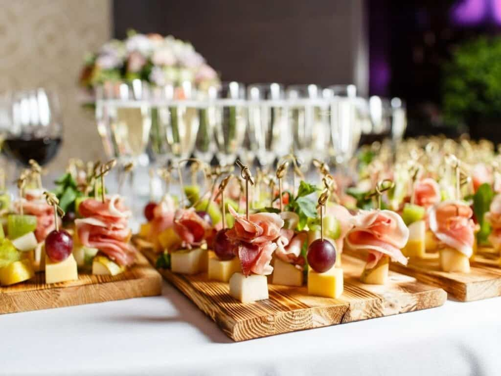 finger foods on wooden boards at a fancy party