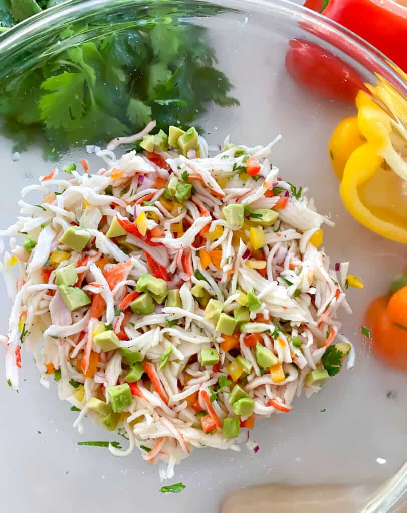 flaked imitation crab meat ceviche in a clear bowl