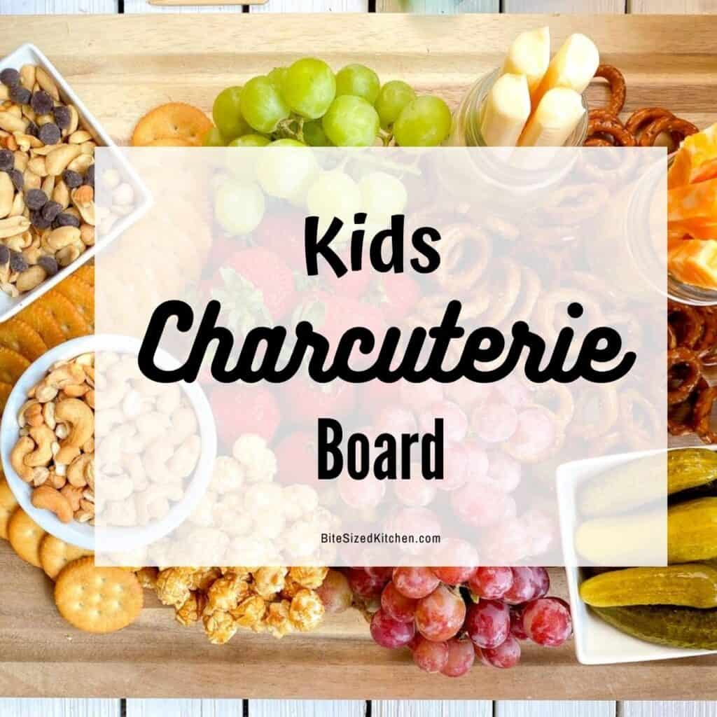 """kid friendly charcuterie platter with snacks, fruits and cheese with overlay """"kids charcuterie board"""""""