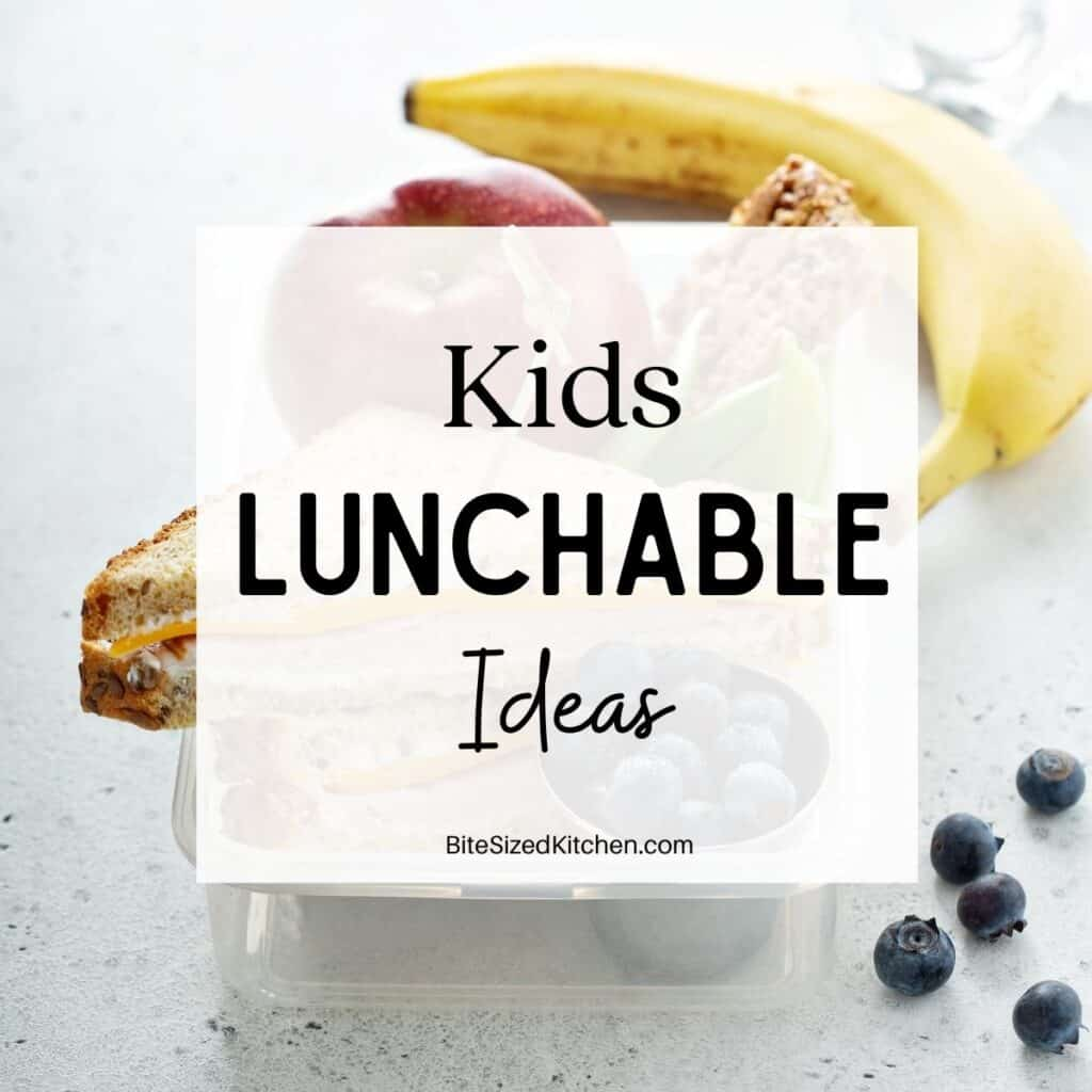 """a banana, apple, blueberries and a sandwich in a lunch box with text overlay staying """"kids lunchable ideas""""."""