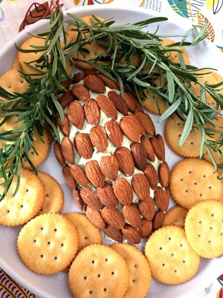cheese ball shaped as a pine cone with crackers