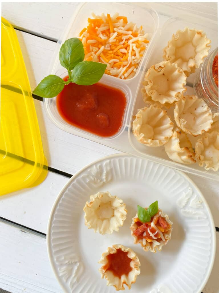 diy pizza lunchbox meal for kids with pizza sauce, pepperoni and cheese