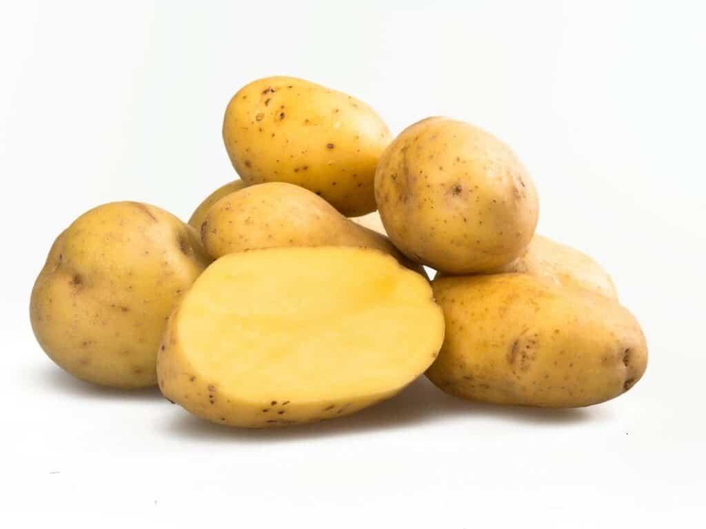 Yellow potatoes stacked.