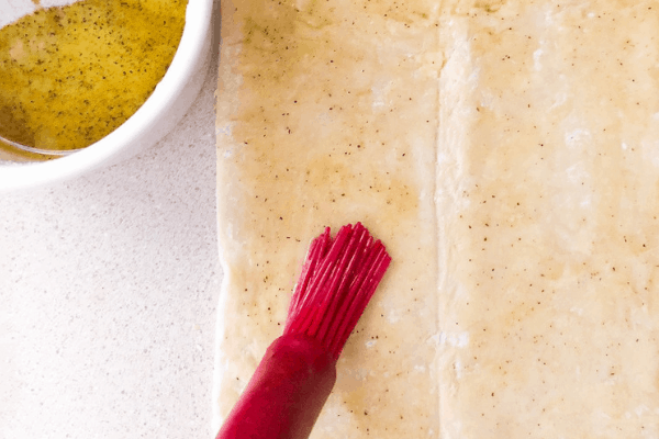 brushing my dough with olive oil