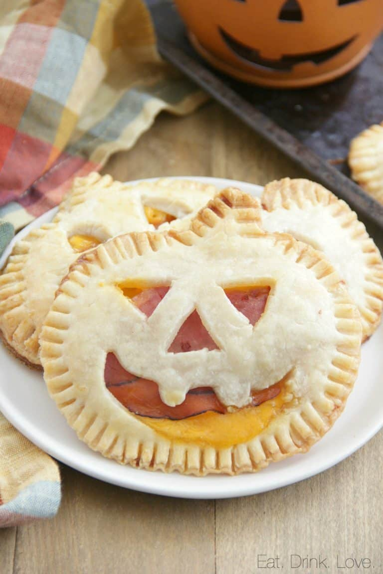 Jack-0-lantern ham and cheese pie appetizer on a plate.