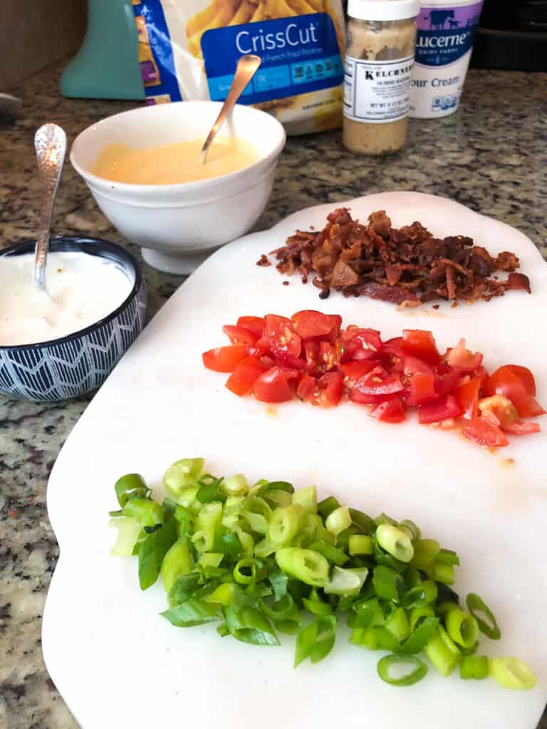 scallions, tomatoes, bacon, cheese and sour cream prepped