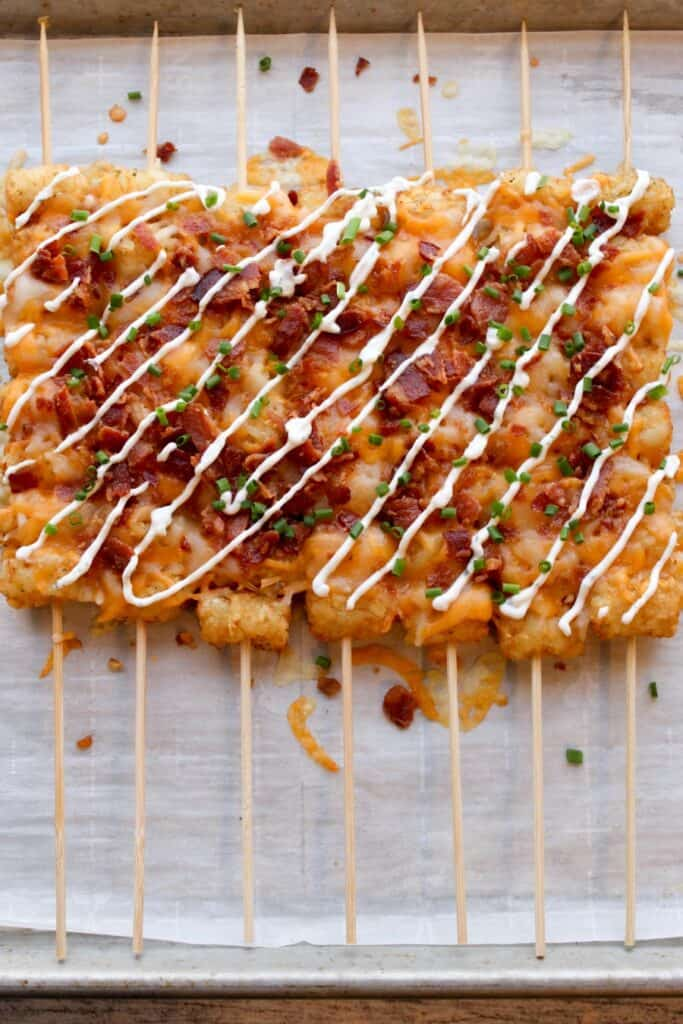 skewered tater tot kabobs on a plate.