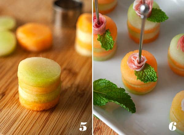 melon and ham appetizer skewers on a plate with mint leaf.