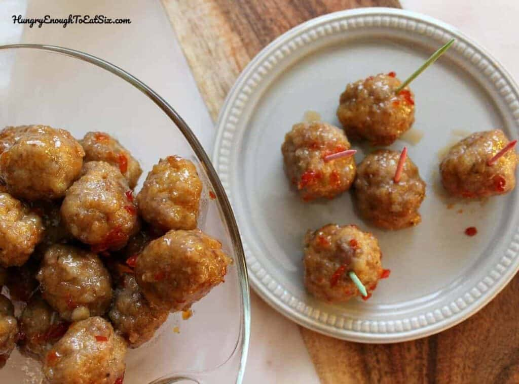 sweet and spicy meatball appetizer skewered with tiny toothpicks.
