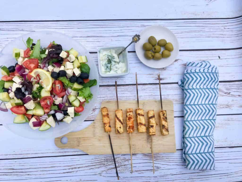 vegan souvlaki appetizers on a long wooden skewer.