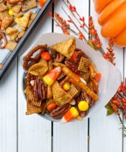 overhead shot of fall chex party mix in a container