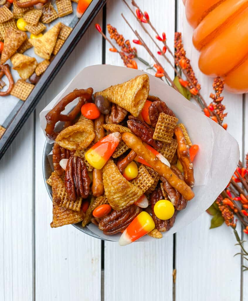 overhead shot of fall chex mix in a metal tin