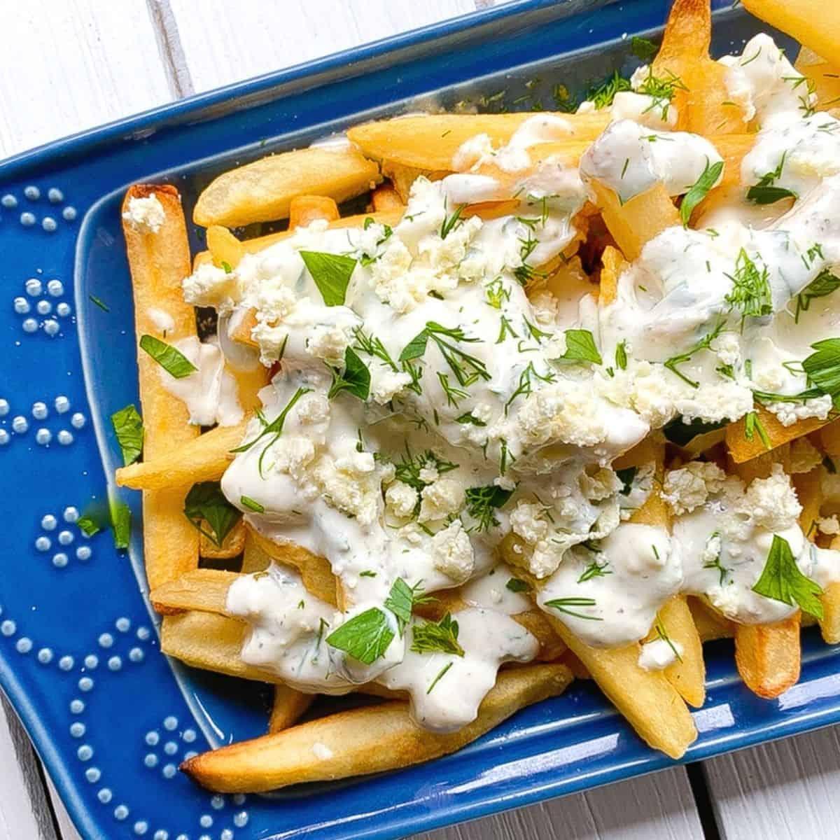 greek feta cheese fries on a blue plate