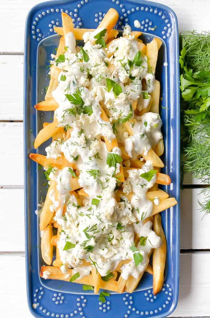 baked french fries smothered in feta cheese and yogurt.