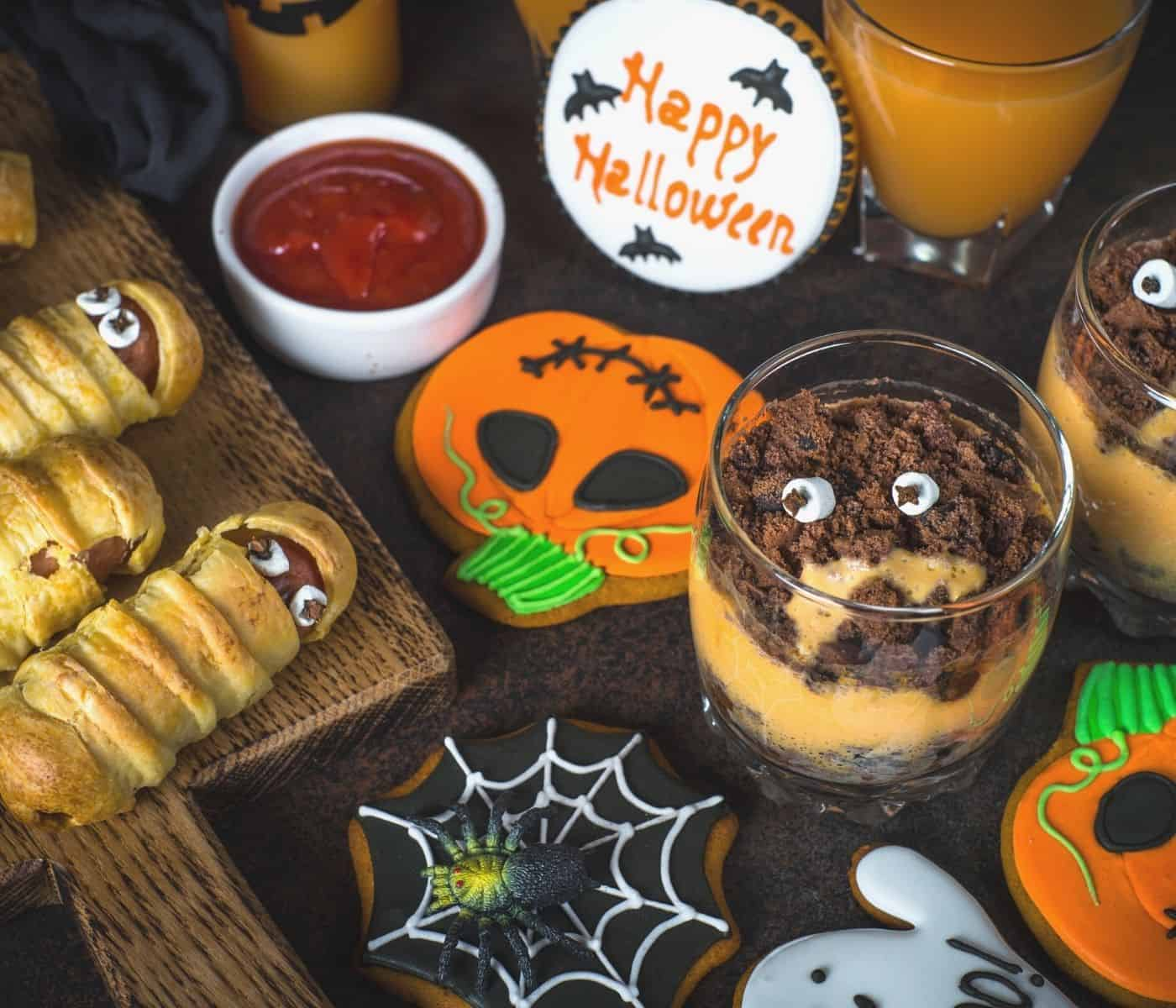 Creep and spooky Halloween party food on a table for adults.