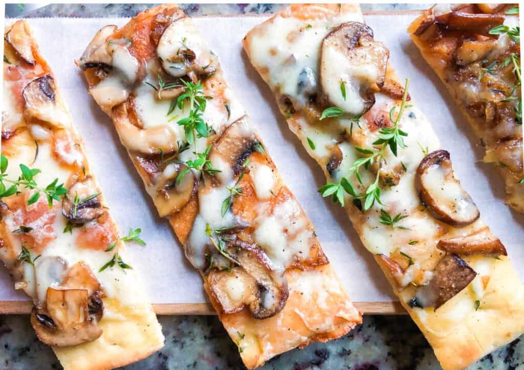 overhead shot of homemade mushroom flatbread on a cutting board