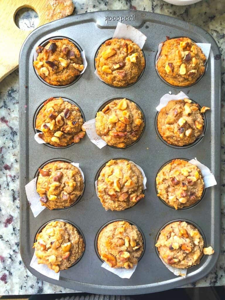 mini banana walnut muffins with honey in a muffin tin