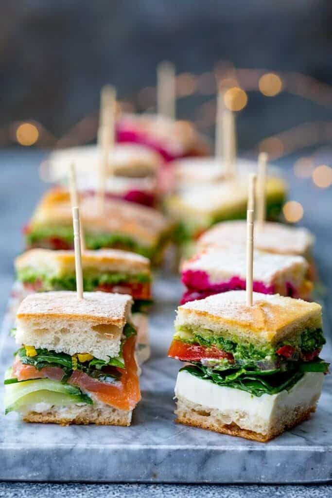 mini fresh pressed sandwiches with toothpick skewers.