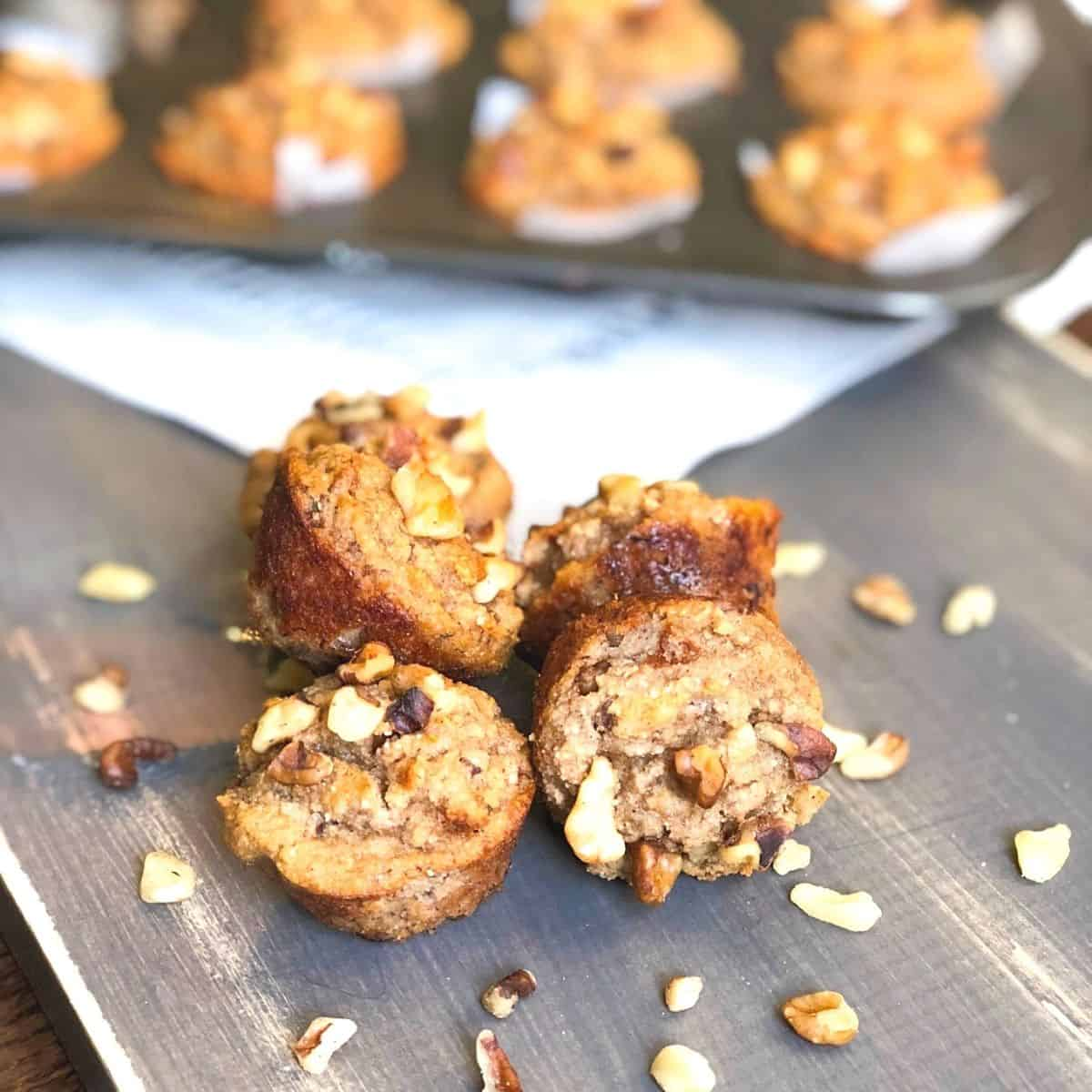 mini banana walnut muffins on a wooden table