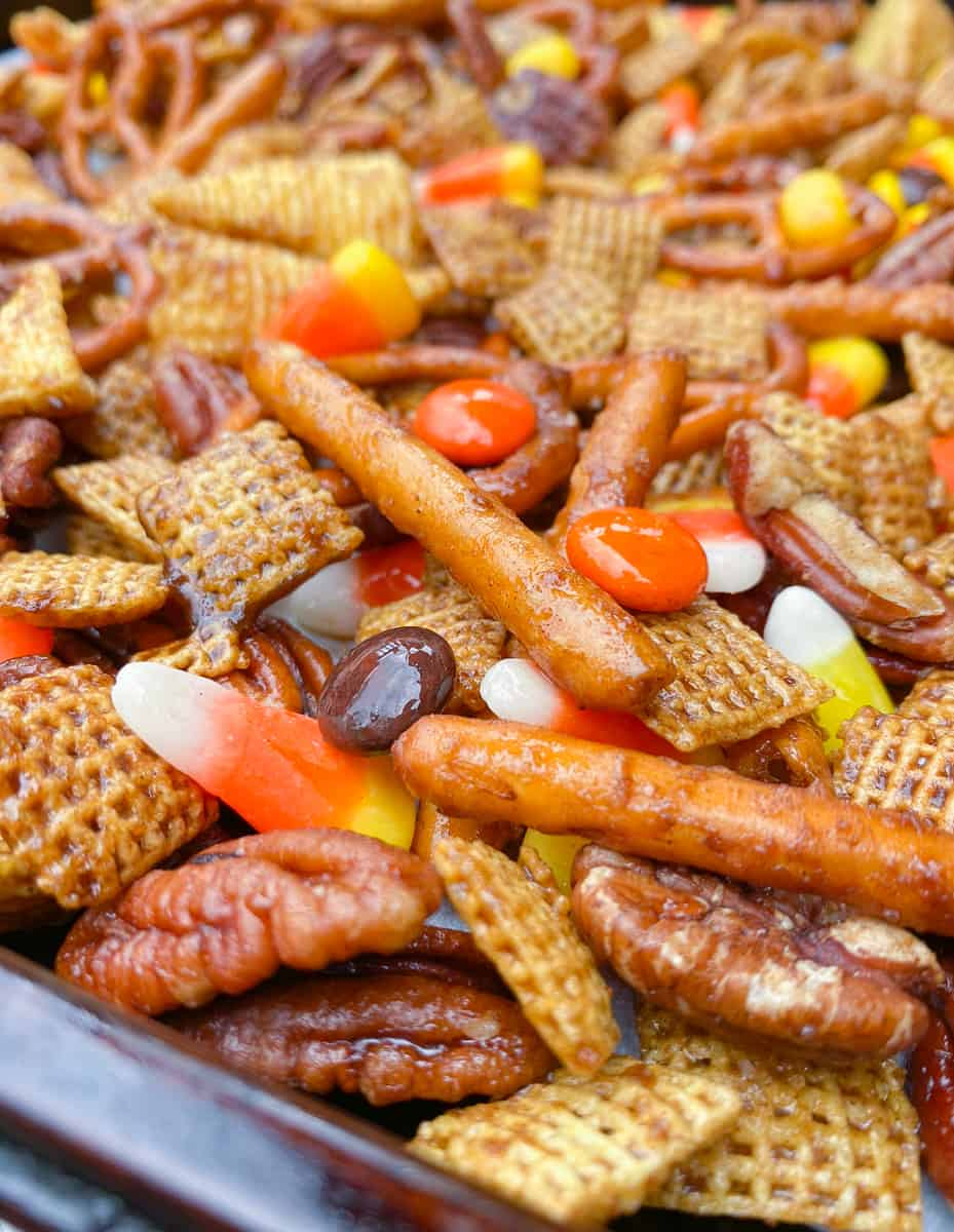 close up of fall Halloween Chex mix with candy corn.