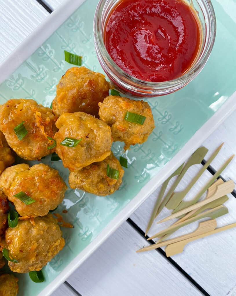 sausage balls recipe without bisquick mix on a plate with ketchup for dipping