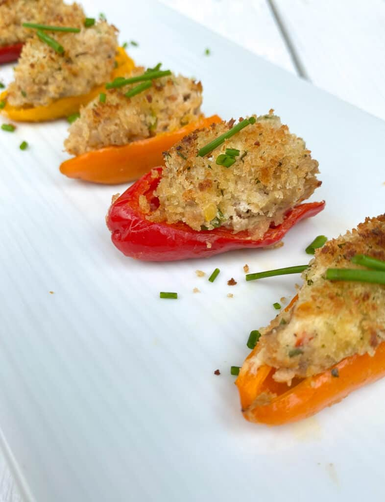 mini bell peppers stuffed with sausage and cream cheese on a plate