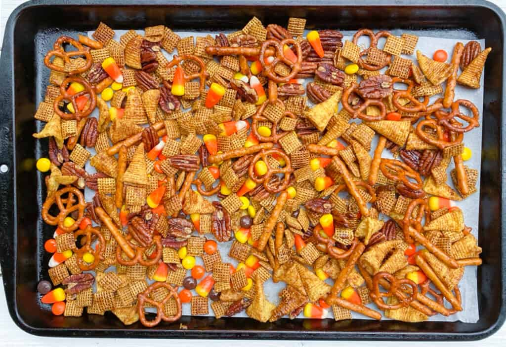 overhead shot of chex mix on a baking sheet