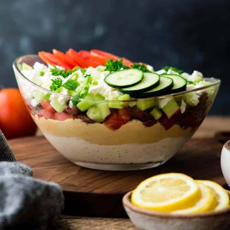 layered dip in a clear bowl