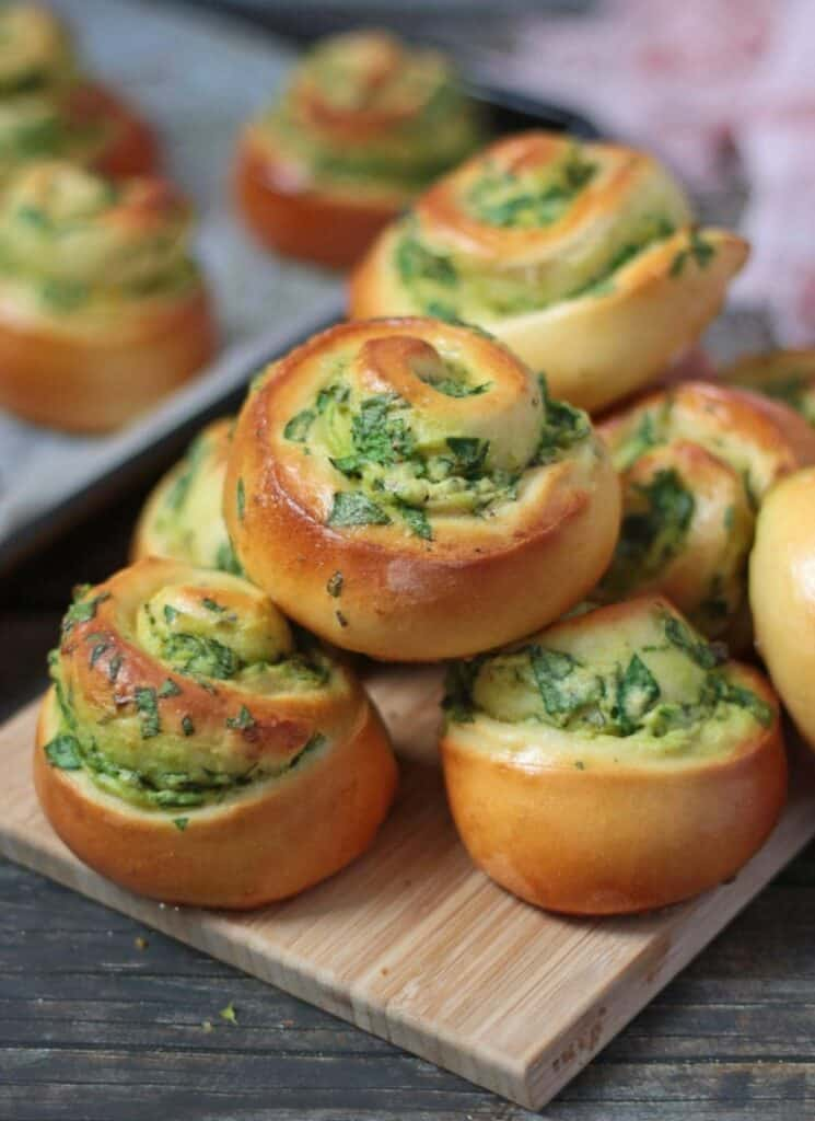 spinach ricotta rolls on a platter