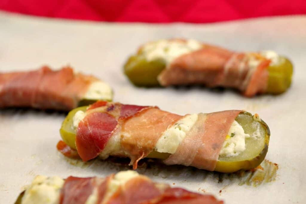 pickles stuffed with cheese and wrapped in prosciutto