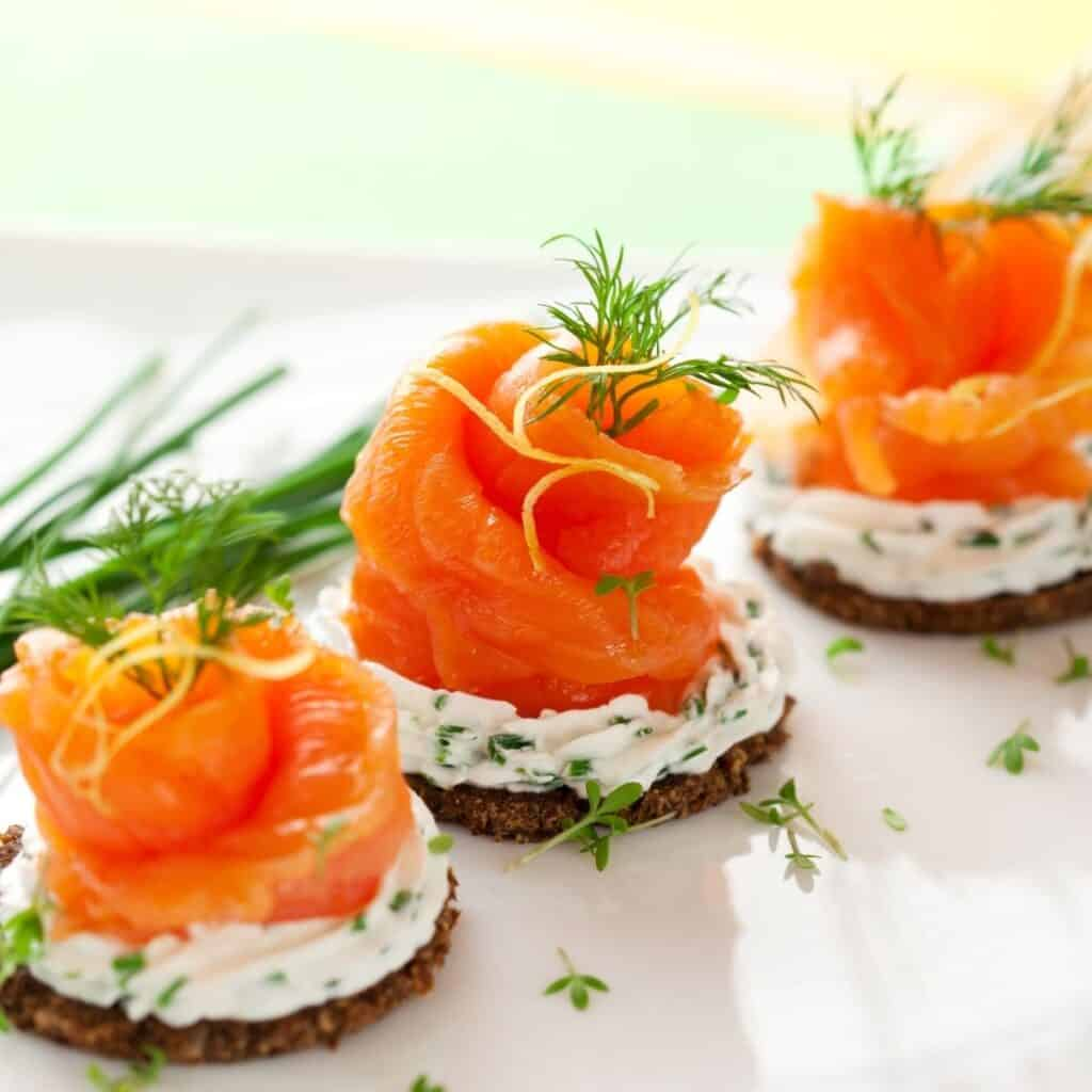 salmon canape ideas on a plate with garnish
