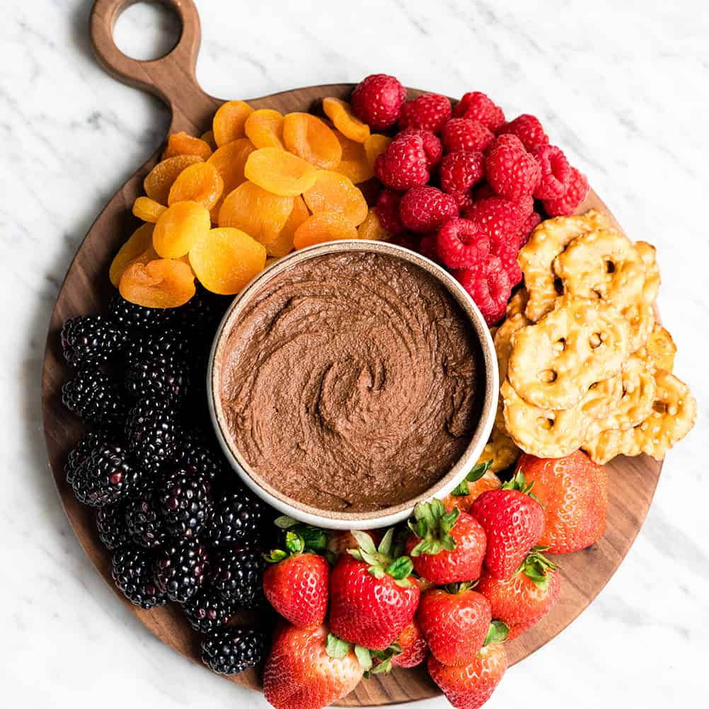 chocolate hummus with fruit and snacks around