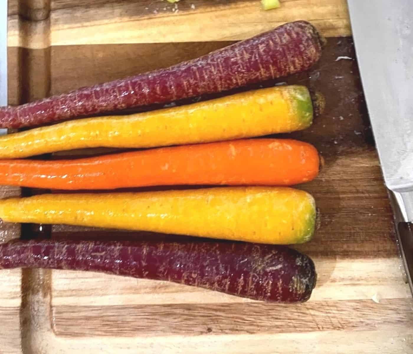 colorful carrots from Farmbox direct on a cutting board.
