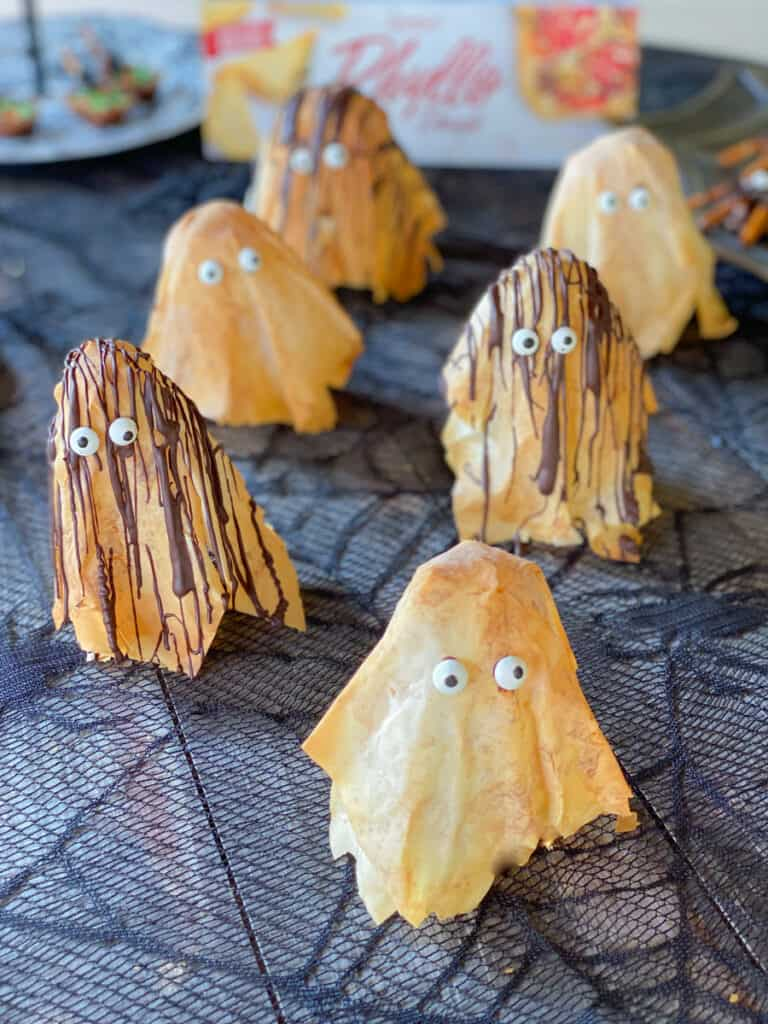 phyllo dough shaped ghosts with chocolate drizzled over top