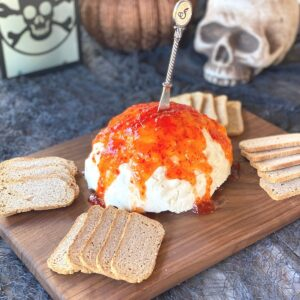 brain mold cheese dip for Halloween with spooky table props