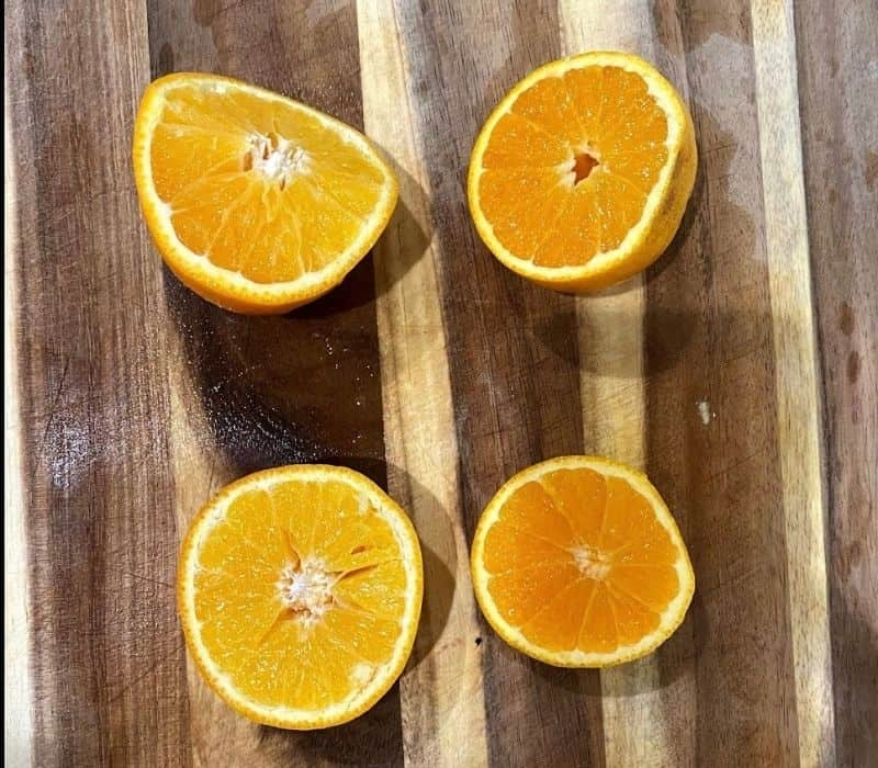 two oranges cut in half