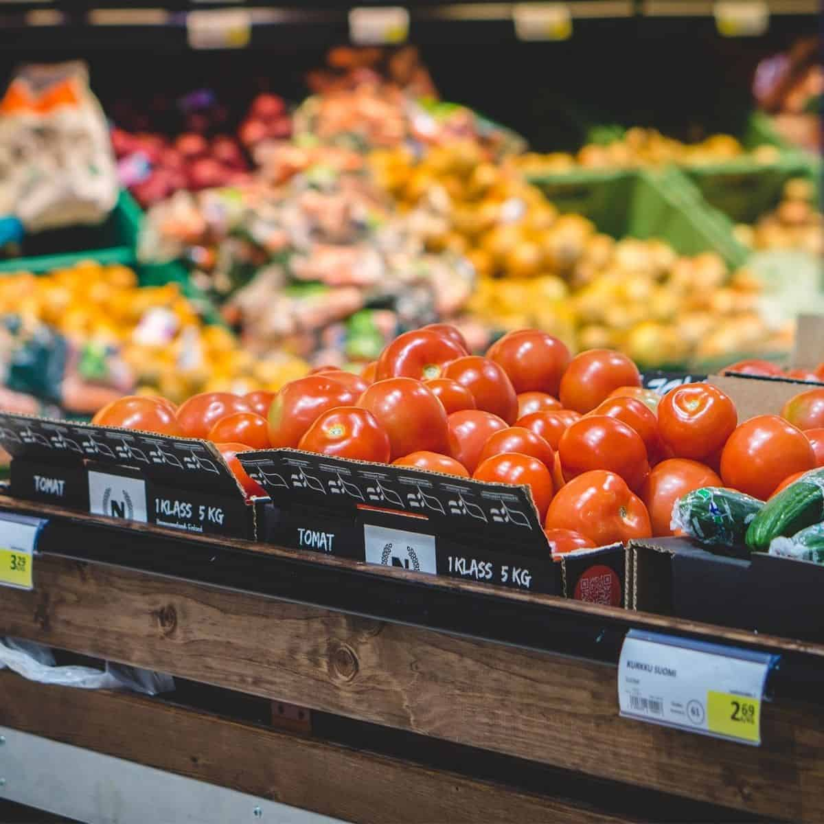 fresh fruits and vegetables aisle in grocery store.